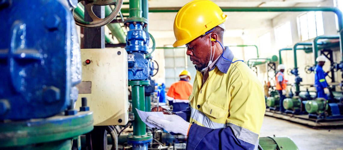 Skilled Machinery Operators Working at a Factory in Africa